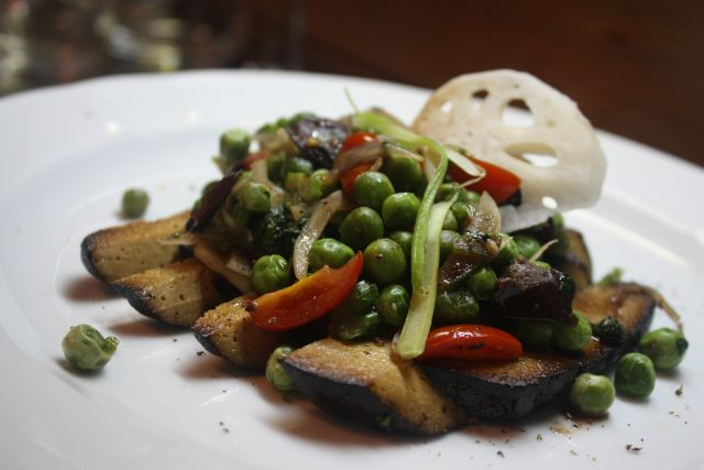Black tofu, sauteed peas with tamarind syrup from Birds in a Row