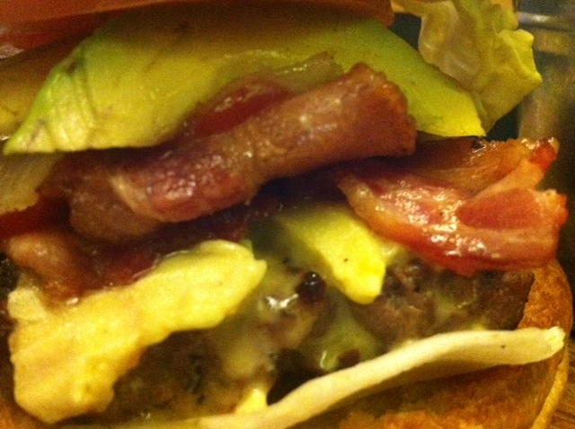 Closeup of the toppings on my Premium Burger from Firehouse (gorgonzola, bacon, avocado and caramelized onions)