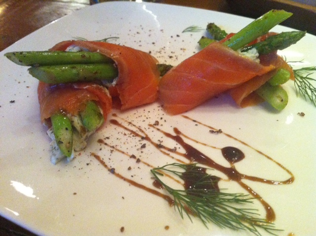 Asparagus planted in dill cheese and wrapped in salmon, an appetizer at Seven Spoons