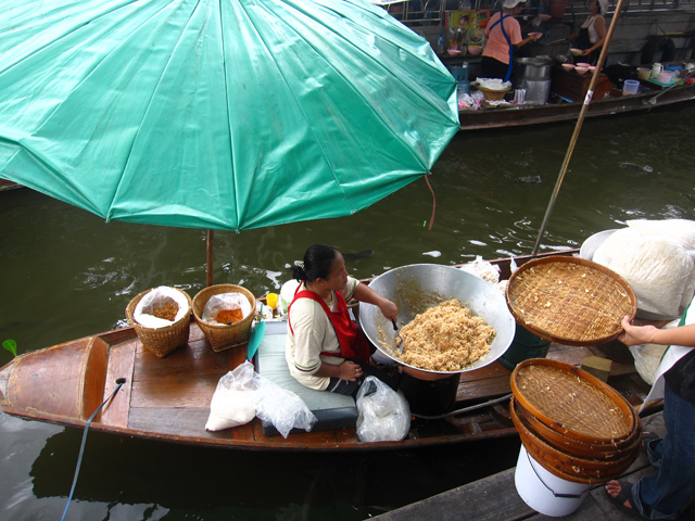 Serving food straight from her boat!