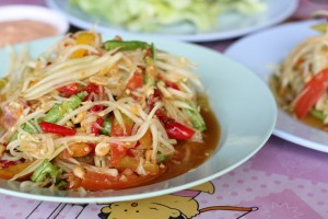 Fresh organic green papaya salad (som tam)