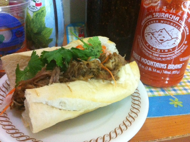 Homemade Vietnamese Pulled Pork Sandwich with Lemongrass & Spicy Sriracha Sauce.