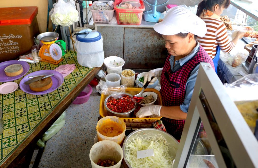 The chef at a local restaurant uses chicken feet in her recipe for papaya salad