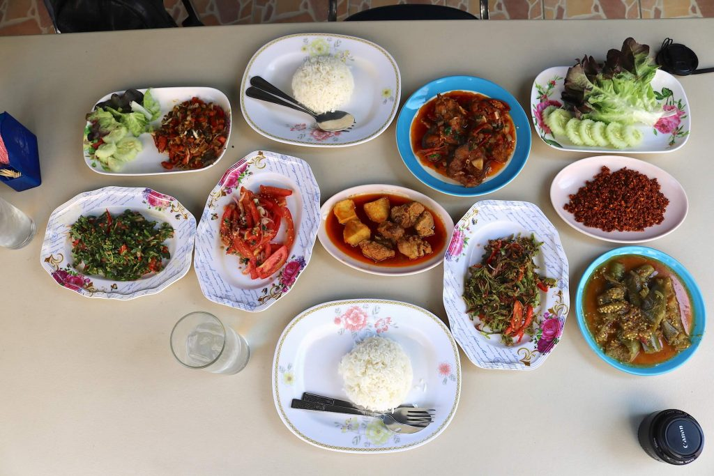 Full Table of Thai-Burmese salads curries, and rice, at at Nong Bee Burmese Library