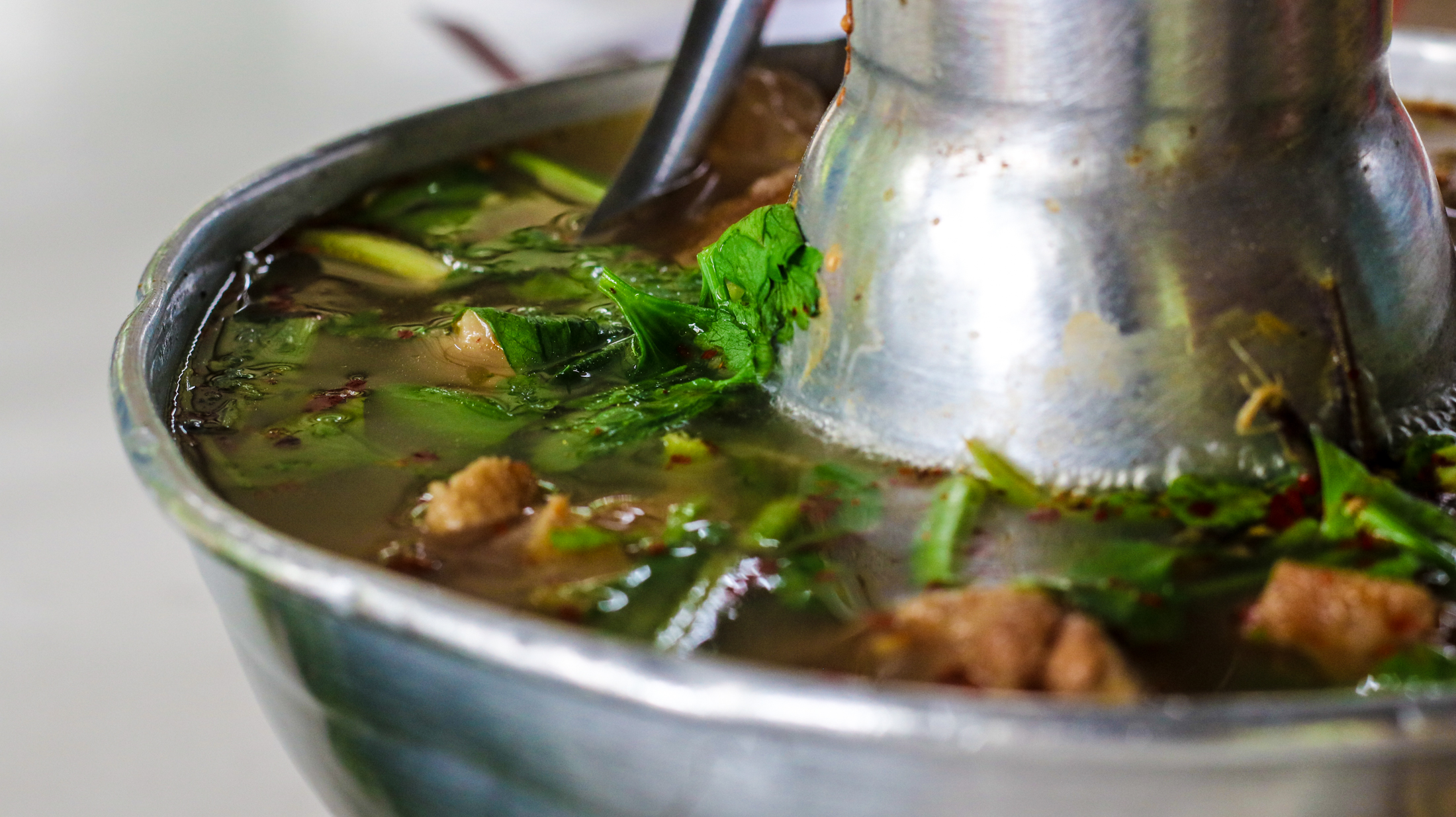 This oxtail soup is full of herbs, like lemongrass, and culantro, as well as huge chunks of the oxtail fatty meat